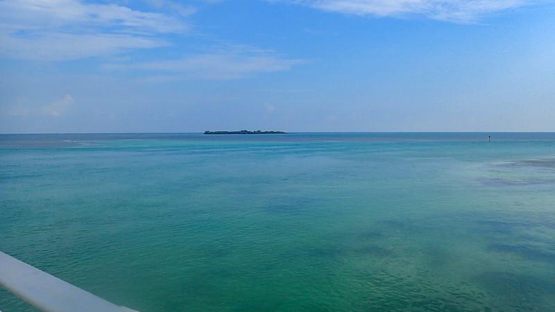 Island in teal-aqua waters