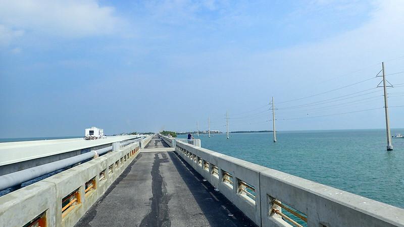 Crossing a narrow bridge with aquamarine waters below