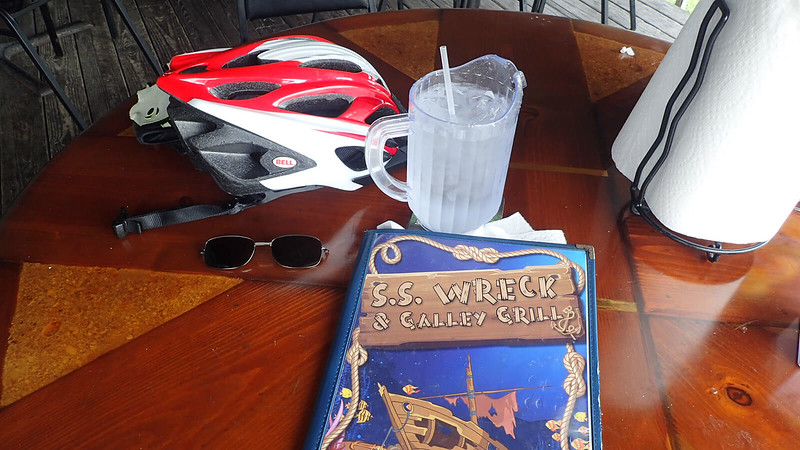 Bike helmet with pitcher of water with straw