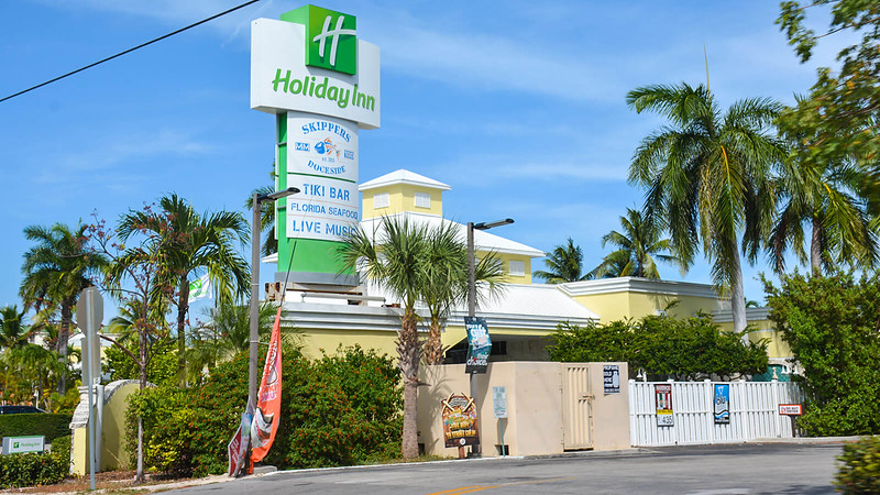 Holiday Inn sign with hotel walls in yellow