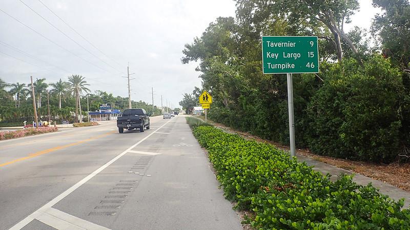Marked bike lane adjoining mileage sign