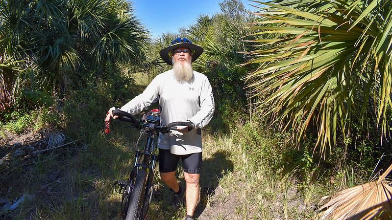John walking his mountain bike