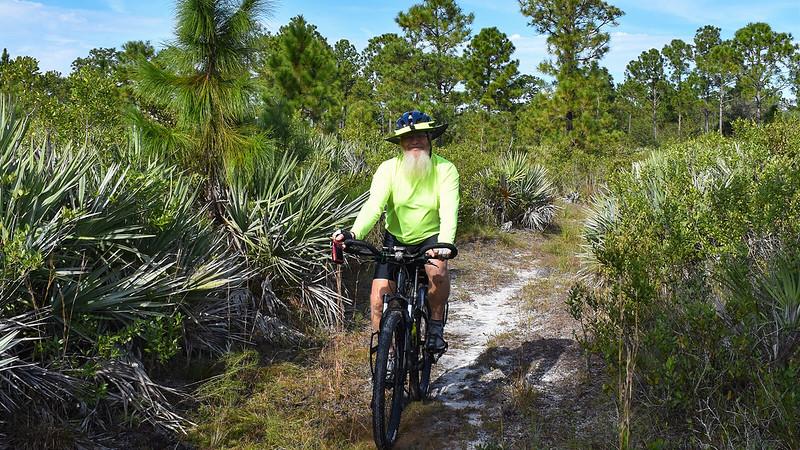 John on his bike in the woods