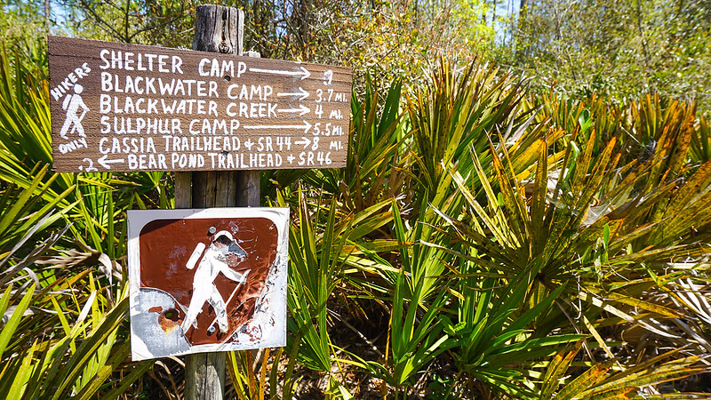 Directional sign with trail miles