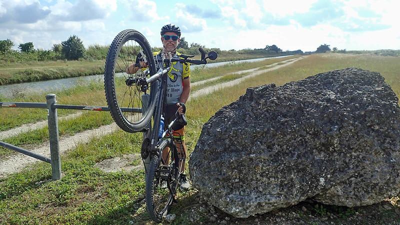 Bill lifts bike through gap