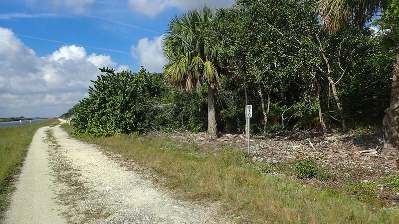 Mileage marker next to path