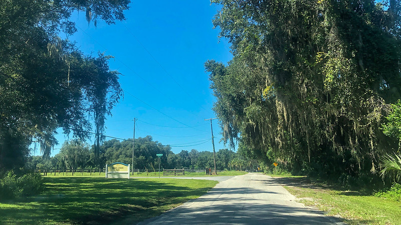 Dirt road with park sign for Chuck Lennon Park