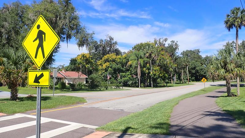 Crosswalk sign and bike path