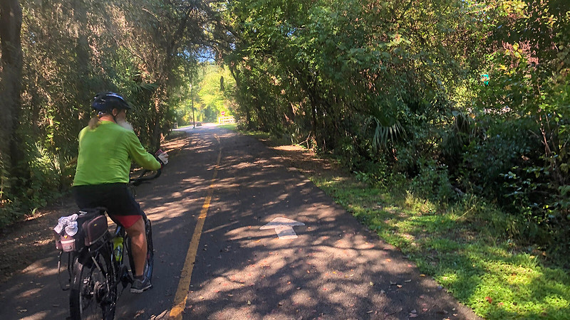 John on bike slowing for road crossing