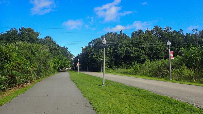 Bike path adjoined by fancy lampposts