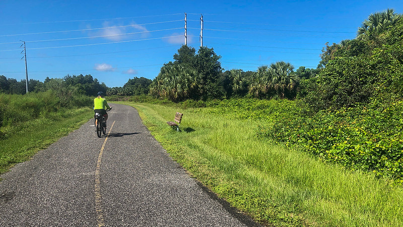 John on bike under power lines