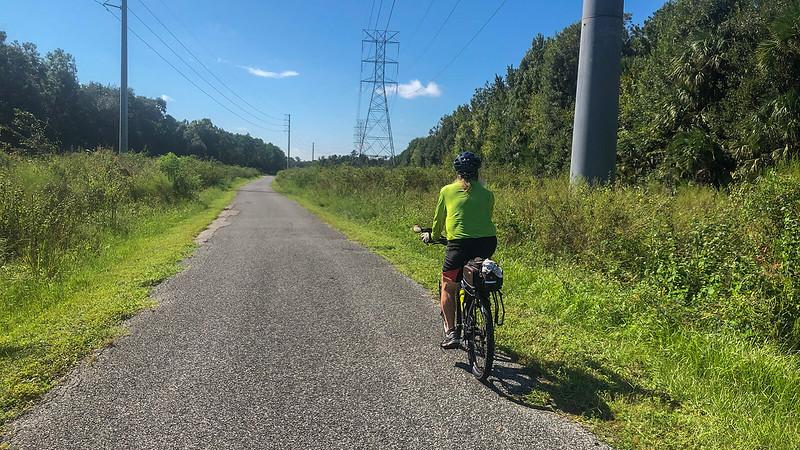 John riding bike between marshes