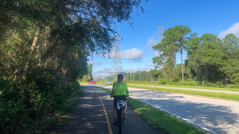 John on bike path near power lines