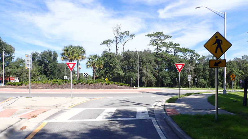 Approaching a roundabout from a rural road