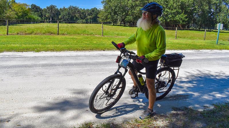 John on his bike looking tired