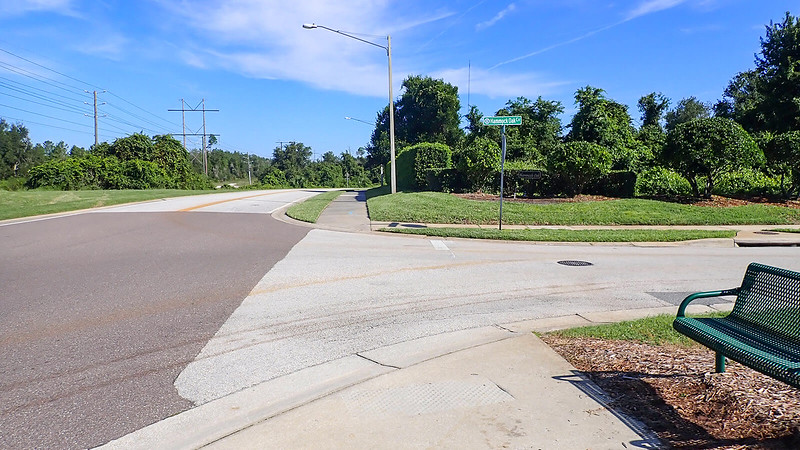 Bike path meets side road and ends