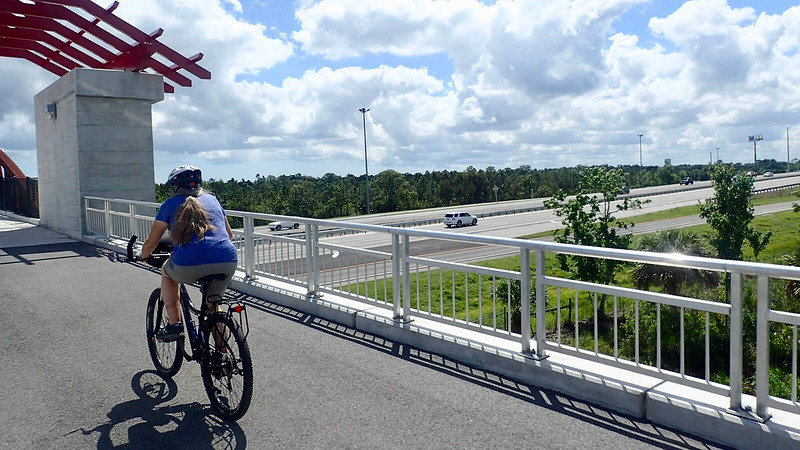 Sandra biking bridge over interstate