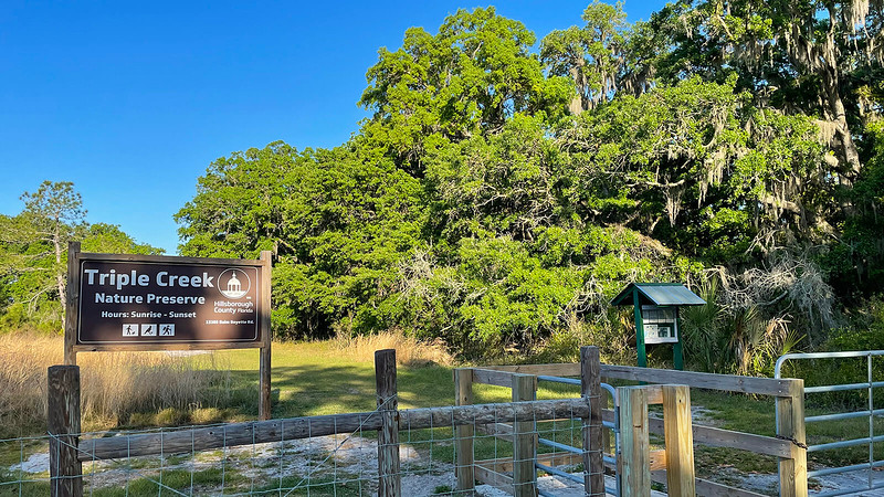 Fence, kiosk, and park sign