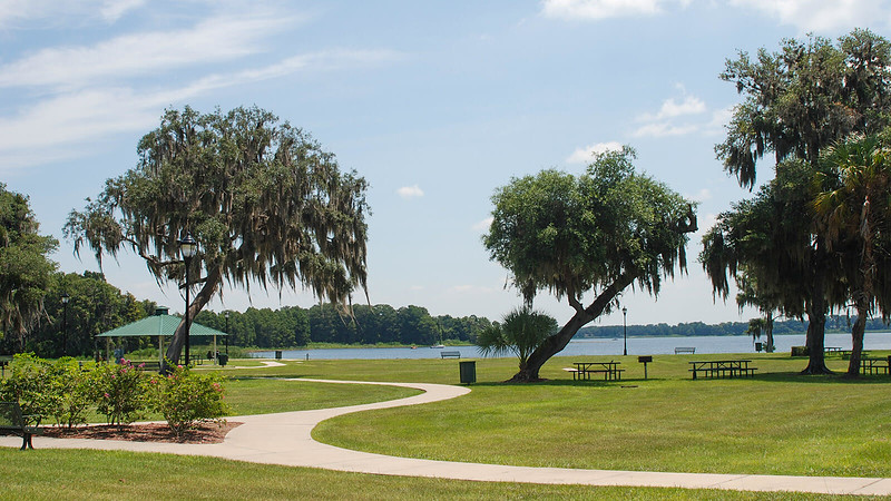Lakefront park with flowers and picnic tables