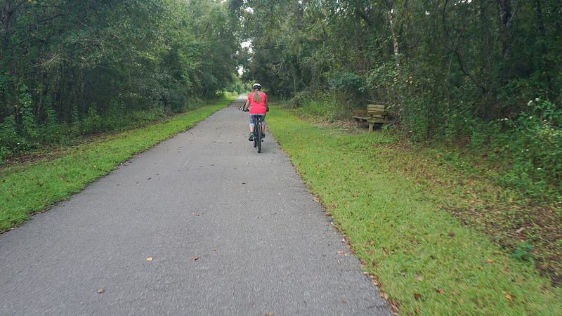 Sandra on a bike path in forest