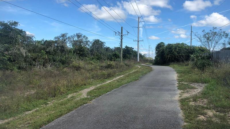 Paved trail under powerline