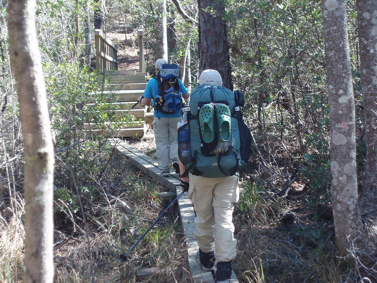 Backpackers crossing Eglin bridge<br /> PHOTO CREDIT: Robert Coveney / Florida Trail Association