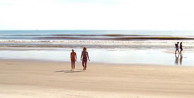 06 New Smyrna Beach Girls Walking on the Shore