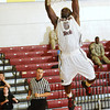 Simon Cummings dunks the ball for Florida Tech during the second half against Trinity Baptist. (Photo by Amanda Stratford, for FLORIDA TODAY)
