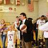 Florida Tech head coach Billy Mims' children Callie, 13, Courtney, 14, and Josh, 9, look on as Mims is presented a team ball for his 500th career win. (Photo by Amanda Stratford, for FLORIDA TODAY)