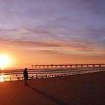 Man enjoying time on the beautiful  beach at sunrise.