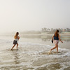 Children enjoying time on the beach on a foggy morning, Daytona Beach Florida, USA.