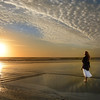 Woman enjoying time  on the beautiful beach at sunrise.