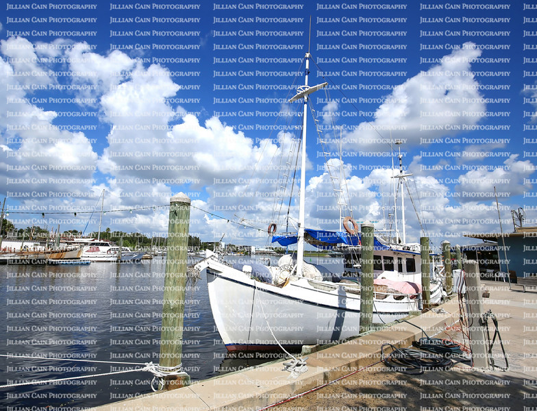 Boats moored at the historic Sponge Docks in Tarpon Springs, Florida.   The sponge industry helped build a Greek community known for sponges, fine restaurants,  markets and bakeries in the country.