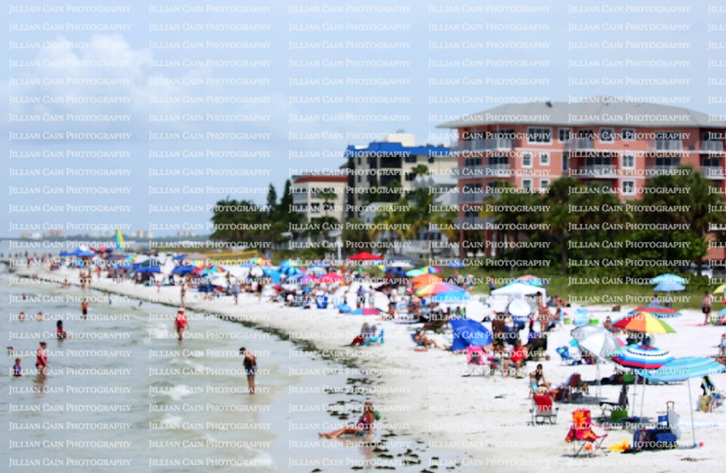Blurred photo of a busy day on the beach by Times Square considered to be the center of Fort Myers Beach in Florida, USA.