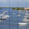 Beautiful sailboats moored at Matanzas Harbor in Fort Myers Beach, Florida as seen from the Fort Myers Beach Bridge