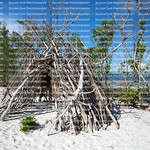 Driftwood tepee shelter built on the white sands of Fort Myers Beach, Florida