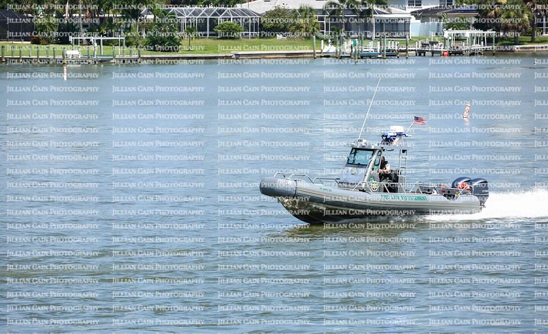 FWC (Florida Fish and WildlifeConservation Commission) officer quickly responding to an emergency with flashing lights and sirens blaring.