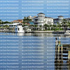 Waterfront homes facing Matanzas Bay in downtown Fort Myers Beach, Florida, USA.
