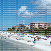 Sun bathers enjoying the beach at Times Square, as seen from the Fort Myers Beach Fishing Pier.