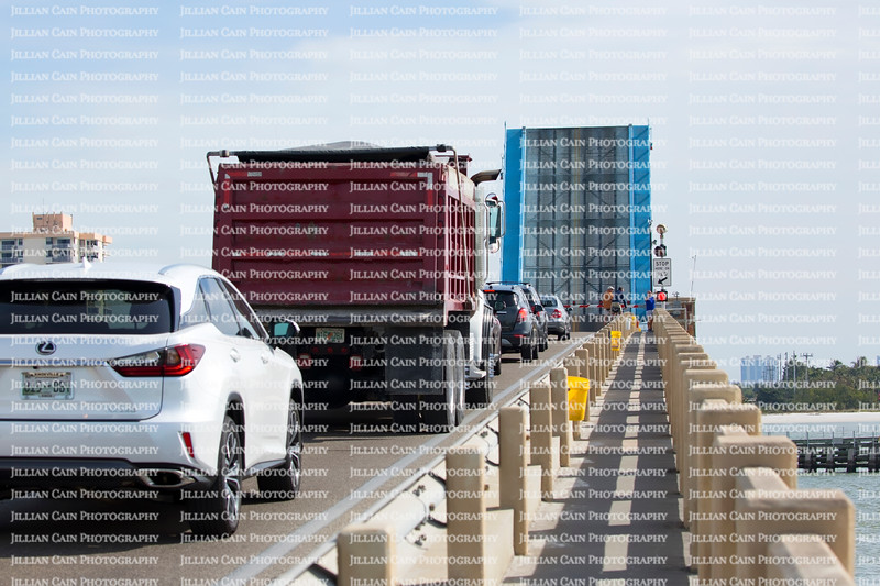 Cars and trucks wait on top of the Big Carlos Pass Bridge as the bridge opens to allow boats across Big Carlos Pass in Fort Myers Beach, Florida.