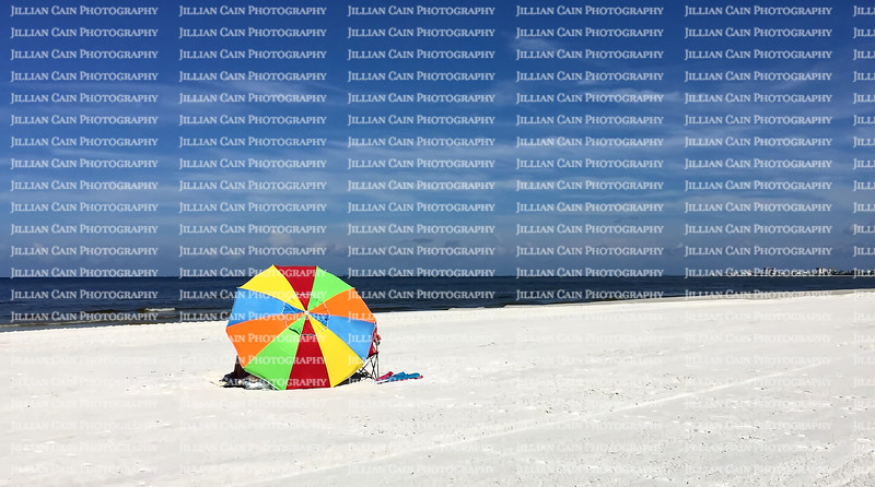 Big colorful beach umbrella on Fort Myers Beach in Florida.