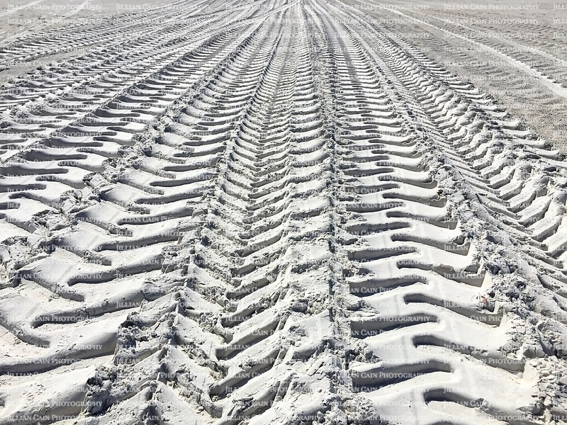 Big truck tire tracks in the sand