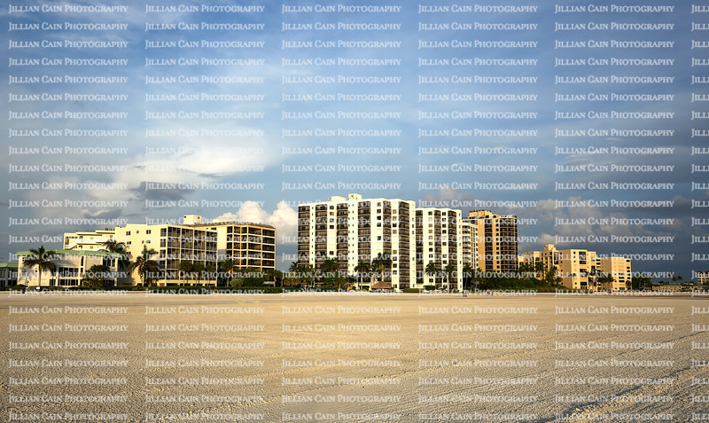 Ocean front hotels, timeshares and apartment rentals as seen on Fort Myers Beach at sunset.