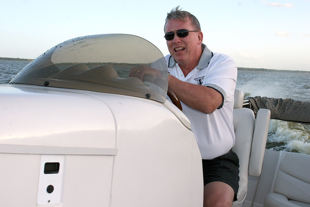 Captain Mike Hanes at the helm of his new boat