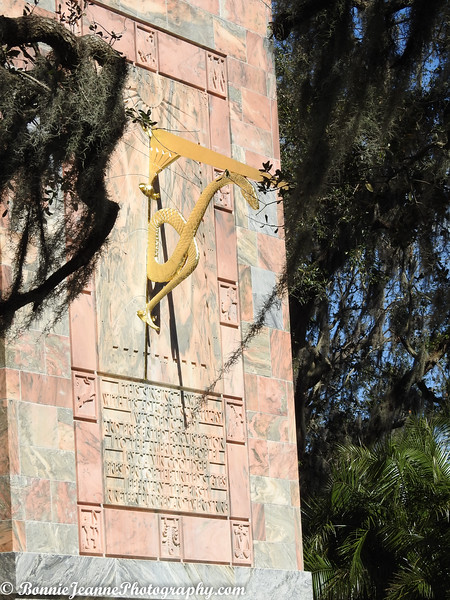 The sundial on the south side of the Tower was set in place on October 26, 1928. The gnomon, which indicates time by casting a shadow on the dial face, is made with a bronze rod supported by a bronze snake – the ancient symbol of time. The hours are marked by the 12 signs of the zodiac. A correction table for different periods of the year is located at the base of the sundial.