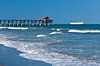 The Pier and beach with cruise ship at Cocoa Beach, Florida, USA.