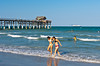 The Pier and beach with cruise ship at Cocoa Beach, Florida, USA.