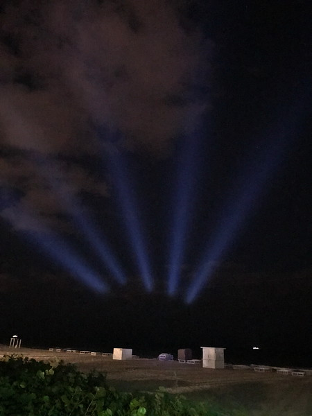 Spotlights Illuminate the New Years Eve Sky over the Atlantic