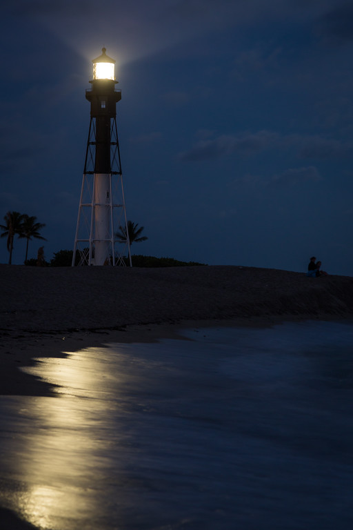 The beach near the Hillsboro Inlet channel glows with the light of moon and the lighthouse. Pompano Beach, FL<br /> <br /> FL-121226-0052
