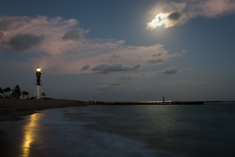 The beach near the Hillsboro Inlet channel glows with the light of moon and the lighthouse. Pompano Beach, FL<br /> <br /> FL-121226-0039